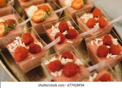 red raspberries  dezert on wedding table - Shutterstock ID 677418934