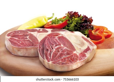 Red raw meat in wooden table