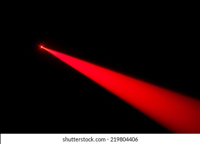 Red real laser beam on black background