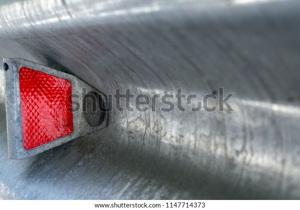 Red reflector on road stop
