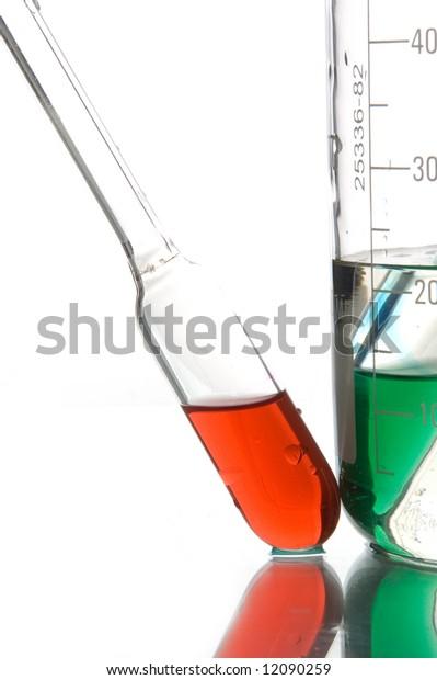 red retort with liquids, white background, close-up