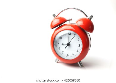 red retro alarm clock on white background