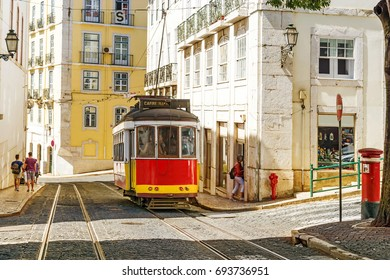 Red retro streetcar in the streets in Lisbon, Portugal