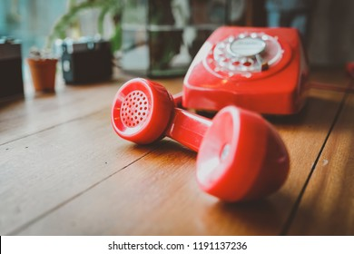 Red retro telephone vintage with hand set on wood table