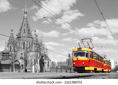 red retro tram on the street of Moscow