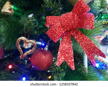 red ribbon and red ball and a heart, christmas decorarion border