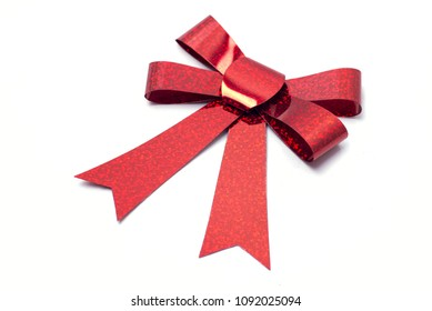Red ribbon with bow isolated on a white background.