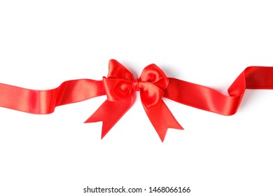 Red ribbon with bow isolated on white background. Gift concept