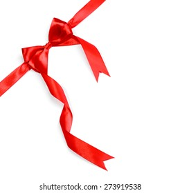 red ribbon with bow with tails isolated on white background