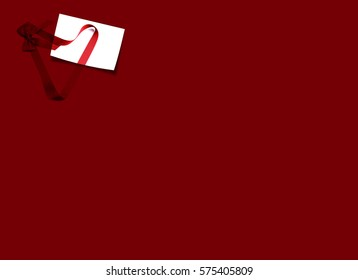 Red ribbon with card on red background