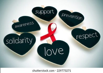 a red ribbon for the fight against AIDS and some heart-shaped blackboards with words such support, prevention, respect, love, solidarity and awareness