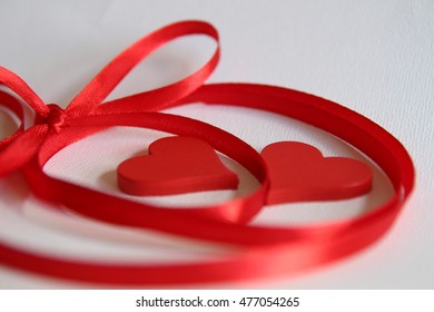 Red ribbon frame with two heart,  isolated on white background. Love