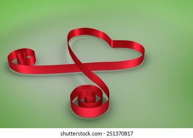 Red ribbon heart against green vignette