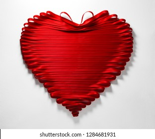 Red Ribbon Heart on Paper Texutred Background.Valentines Day or Wedding Love Concept.