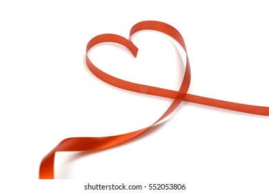 red ribbon heart shape isolated on white background