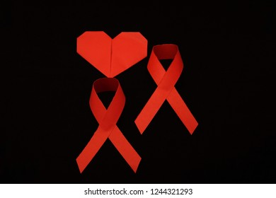 Red ribbon with love as symbol of aids awareness on world aids day