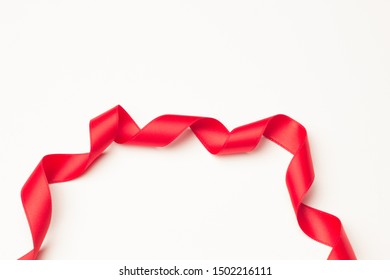 Red ribbon to make ties in Christmas gifts. Ribbon and bows to decorate anniversary gifts, various gifts.