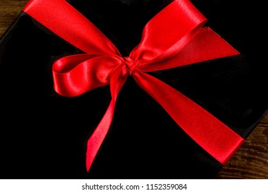 red ribbon on a black background