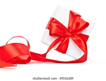 Red ribbon on gift. Isolated on the white background