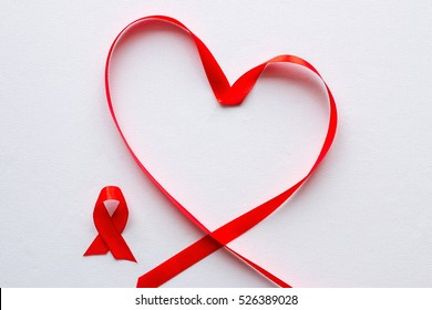 red ribbon in the shape of a heart and a symbol of World AIDS Day