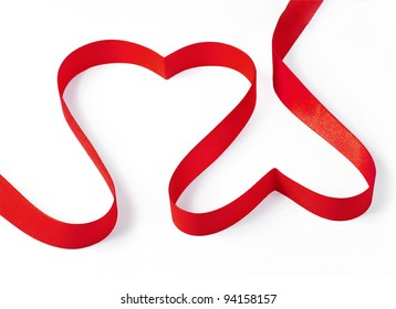 Red ribbon shaped as a heart isolated on white