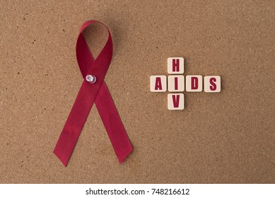 red ribbons (aids ribbon) with AIDS/HIV word on notice board.Aids / HIV Concept. healthcare and medical concept.