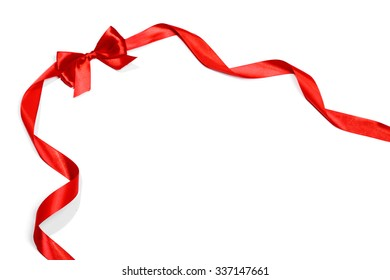 Red ribbons with bow with tails isolated on white background