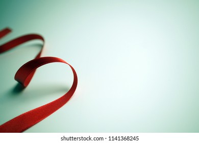 red ribbons on blue background for shopping , anniversary , new year , Christmas and celebration concept