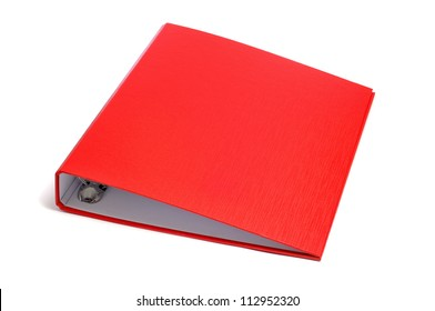 a red ring binder on a white background