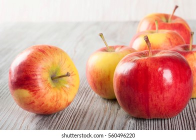 Red ripe apples on a wooden table