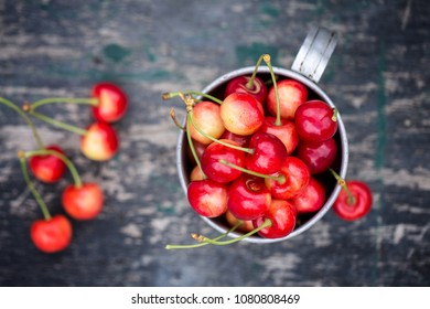 Red ripe juicy cherry in an old mug