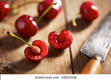 Red ripe open cherry on wooden background