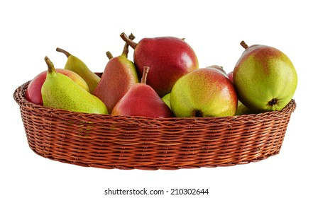 Red ripe pears in the wicker basket, isolated on white background