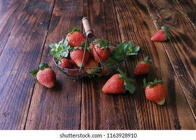 Red ripe strawberries on wooden surface background