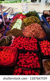 Red ripe tomatoes on the market in Turkey. It is the province of Antalya. Here in Belek different vegetables are sold at the market.