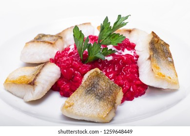 red risotto with white fish fillet