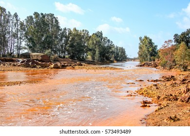 Red river watermill with red - yellow acid stones. Red tinted river by copper on the ground. Water used in life study for life detection in Mars
