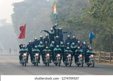 RED ROAD, KOLKATA, WEST BENGAL / INDIA - 21ST JANUARY 2018 : Indian miltary men showing their bike riding skills at motorbike rally - several army men on bikes, India's republic day celebration trial.