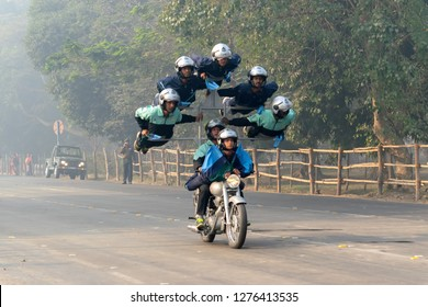 RED ROAD, KOLKATA, WEST BENGAL / INDIA - 21ST JANUARY 2018 : Indian miltary men showing their bike riding skills at motorbike rally - seven men on a bike , preparing for India's republic day.