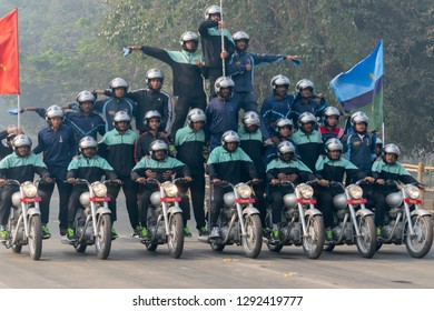 RED ROAD, KOLKATA, WEST BENGAL / INDIA - 21ST JANUARY 2018: Indian miltary men showing their bike riding skills at motorbike rally - several army men on bikes , preparing for republic day celebration.