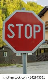 red road stop sign closeup