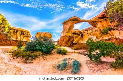 Red rock canyon desert sandstones landscape. Mountain arch in red rock canyon desert sandstone view. Sandstone mountains in red rock canyon desert scene. Red rock canyon desert sandstones