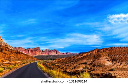 Red rock canyon road landscape. Mountain valley road in red rock canyon scene. Red rock canyon road in mountain valley landscape. Red rock canyon road view