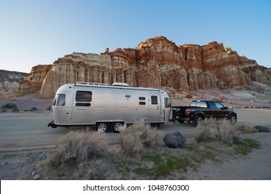 RED ROCK CANYON STATE PARK, CA/USA - FEBRUARY 26, 2017: Recreational vehicles, including an Airstream travel trailer, shown by the Red Cliffs along California State Route 14.