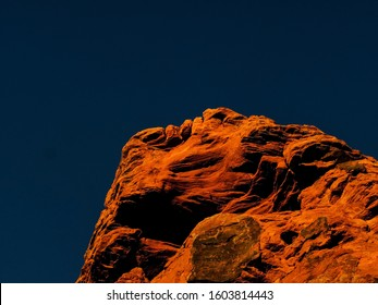 Red Rock cliff face above St. George, UT.  If you look closely at the top there appears to be a head figure with eyes, nose and a mouth