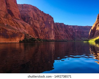 Red Rock Cliffs reflecting in the water of the Colorado River between Glen Canyon Dam and Lee's Ferry