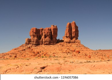 Red rock formation on the Navajo Indian Reservation near Shiprock in northern New Mexico with blue sky and rocky copy space.