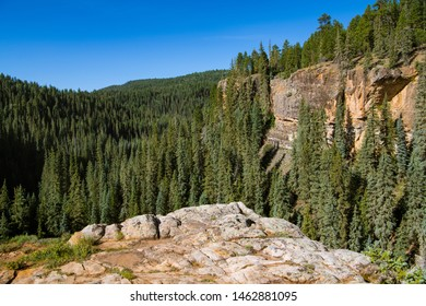 Red rock sandstone canyon wall and rock outcropping above the Piedra River near Pagosa Springs, Colorado