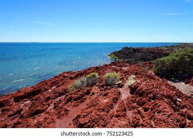 Red rock shore at Punta Tombo near Trelew