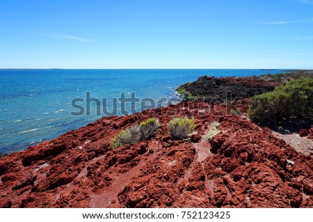Red rock shore at Punta Tombo near Trelew